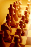 Chess pieces in yellow ambient light Royalty Free Stock Photography