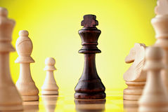 Chess pieces on a yellow background Stock Photo