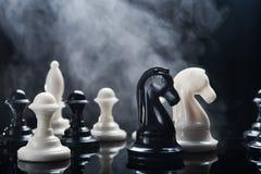 Chess piecess and smoke Stock Photos