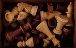 Chess pieces in a box. Chess piecess in a wooden box Stock Image