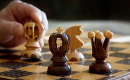 Chess play with focus to black king in front Royalty Free Stock Image