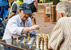 Chess play. Two men playing chess outdoors in summer 2014 in Belgrade, Serbia Stock Photo