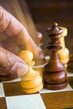 Chess player. Wooden chess game and hand stock image