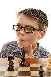 Chess player analyzing move Stock Photography