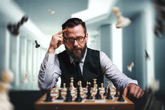 Chess player calculate movies and game strategy stock photo