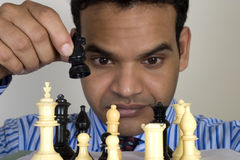 Chess player, check mate. Young Indian chess player playing chess Stock Image