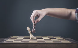 Chess. Player making the last move - check mate Royalty Free Stock Photography