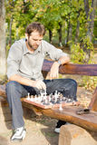 Chess player making a move Royalty Free Stock Photos