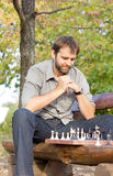 Chess player working out his strategy Stock Photo