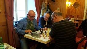 Chess players in Café Mozart, Salzburg. Cafe Mozart - Salzburg, Austria Stock Photo