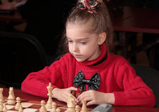 Chess playing. Child 8 years old playing at chess competition Stock Photos