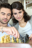 Chess playing couple Stock Photos