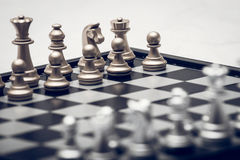 Chess position for the winners. Chess pieces in different combinations on a black and white board Royalty Free Stock Images