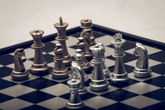 Chess position for the winners. Chess pieces in different combinations on a black and white board Royalty Free Stock Photos