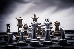 Chess position for the winners. Chess pieces in different combinations on a black and white board Stock Images