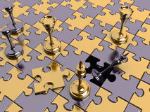 Chess on a puzzle board with a missing piece Royalty Free Stock Image