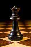 Chess queen as leader on chess board Royalty Free Stock Photo
