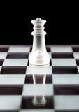 Chess queen on chess board Stock Photos