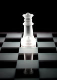 Chess queen on chess board Royalty Free Stock Image