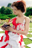 Chess queen holds a large bottle of perfume Stock Photography
