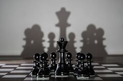 Free Chess Queen Standing On A Chessboard With Pawns Around Her. Women Leadership Concept Royalty Free Stock Photos - 212242388