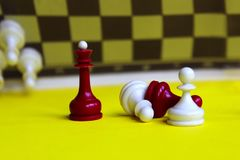 Chess Queen. Strategy game. Red And white Piece. Chess Background. Red And White Chess on Yellow Background. Chess Business Concept, Success.Chess Figures stock photos