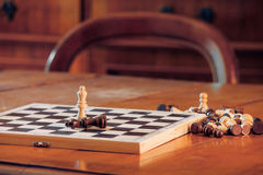 Chess queens on table in a room. Royalty Free Stock Photos