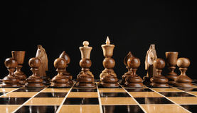 Chess in ranks. On black background Royalty Free Stock Photos