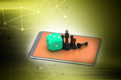 Chess with red cube and smart phone Royalty Free Stock Image