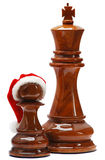 Chess with santa hat Royalty Free Stock Images