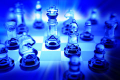 Chess set in blue Royalty Free Stock Photos