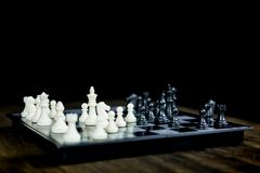 Chess set on the chess board of business ideas and competition and stratagy plan success meaning stock image