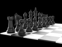 Chess Set and Board. Chess board with starting positions aligned chess pieces, isolated on black background Stock Photos