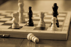 Chess set and chess pawn on wooden table, game and strategy concept. Royalty Free Stock Photos