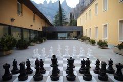 Chess set in courtyard, Santa Maria de Montserrat Abbey, Barcelona Royalty Free Stock Image