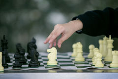 Chess set in motion. Hands of man playing competing chess match Stock Photography