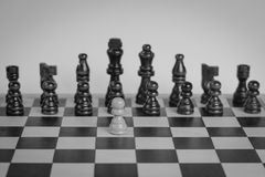 Chess set with one chess pawn in front. Royalty Free Stock Images