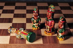 Chess set between Spaniards and Incas. King defeated by the Incas. Chess set between Spaniards and Incas, made from ceramic, in Ecuador Stock Image
