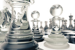 Chess set, victory, transparent glass figures, on a chessboard, 3d rendering Royalty Free Stock Images