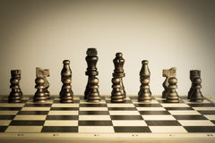 Chess set vintage sepia color. Royalty Free Stock Photography