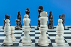 Chess set with white and black wooden pieces. Stock Photo