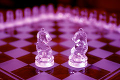 Chess Sets. Two knights in purple Stock Images