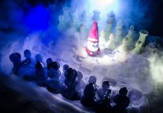 Chess in the snow. winter concept. Christmas or New Year present on a chessboard with Santa Claus on a dark background. Copy space. Selective focus stock photos
