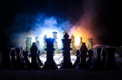 Chess in the snow. winter concept. Christmas or New Year present on a chessboard with Santa Claus on a dark background. Copy space. Selective focus Royalty Free Stock Photos