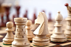 Chess on star. Chess white figure on start the game Royalty Free Stock Images