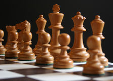 Chess, the start. White chess pieces on board at start of game Royalty Free Stock Images