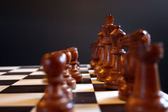 Chess, the start. Black chess pieces on board at start of game Royalty Free Stock Photo