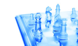 Chess Strategy. Chess pieces on section a chess board isolated on white Stock Photo