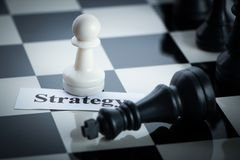 Chess strategy concept. Chess on the chess board Stock Photos