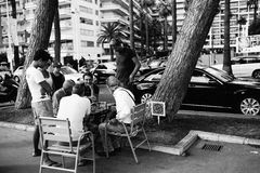 Chess in the street, Monako. Men play chess in the street in Monaco. Black white colored image Stock Image